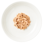 Isolated Aerial image of Reveal tuna cat food on plate