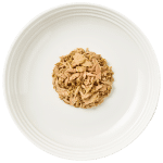 Isolated Aerial image of Reveal tuna cat food with seaweed on plate