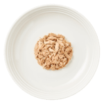 Isolated aerial image of Reveal tuna cat food with crab on plate