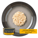 Isolated aerial close up of Reveal chicken cat food on a plate