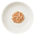Isolated aerial image of Reveal tuna cat food with shrimp