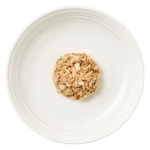 Isoated aerial image of Reveal mackerel cat food with tuna & seabream on plate