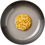 Isolated aerial image of Reveal Chicken cat food with pumpkin on a plate