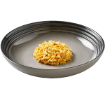 Isolated image of Reveal Chicken cat food with cheese on a plate